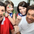 Stock Photo: Two couples supporting Italifootball