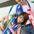 Italian couple on couch waiting for soccer match — Stock Photo