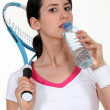 Stock Photo: Tenniswomtaking sip of water.