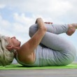 Woman practicing yoga — Stock Photo