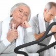 Stock Photo: Couple of seniors having exercise