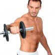 Man lifting a dumbbell — Stock Photo #10519152