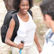Mixed-race couple hiking — Stock Photo