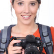 Stock Photo: Womwith DSLR camera