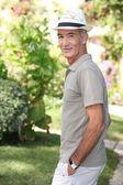 Senior man walking in the garden — Stock Photo