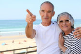 Senior couple on the beach — Stock Photo