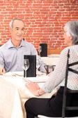 Mature couple in restaurant — Stock Photo