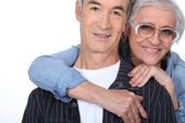 Elderly woman hugging her husband — Stock Photo