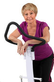 Senior woman doing exercises in the gym — Stock Photo