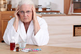 Older woman with medicine — Stock Photo