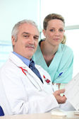Doctor and nurse coffering — Stock Photo