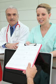 Nurse by collecting medical report — Stock Photo
