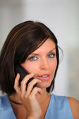 Brunette listening attentively to phone call — Stock Photo