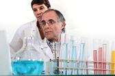 Scientists conducting experiments — Stock Photo