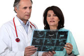 Doctor and nurse examining a scanner image — Stock Photo