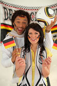 Overjoyed man and woman supporting Germany — Stock Photo
