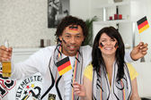 German couple supporting their national team — Stock Photo