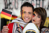 Couple supporting German football team — Stock Photo