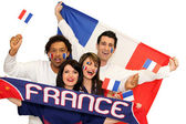 Cheerful men and women supporting France — Stock Photo