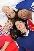 Four young adults supporting the French soccer team — Stock Photo