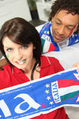 Couple supporting the Italian soccer team — Stock Photo