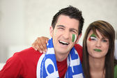 Italian couple going to watch a soccer game — Stockfoto