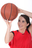 Young female basketball player — Stock Photo