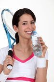 A tenniswoman having a sip of water. — Stock Photo