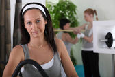 Woman working out at the gym — Stock Photo