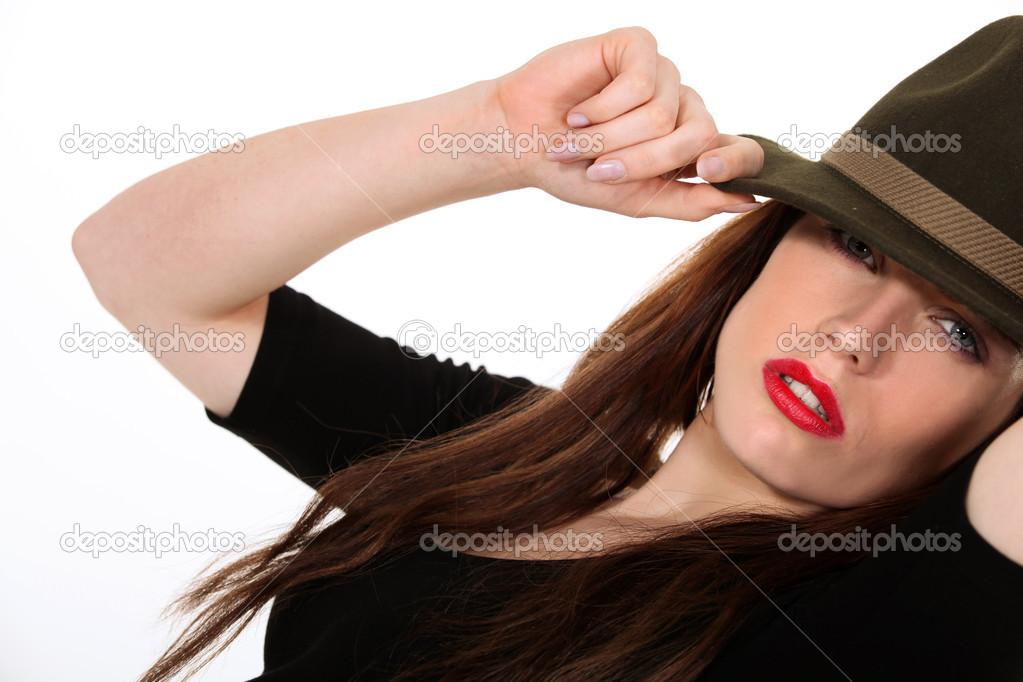 Mysterious woman wearing a Fedora hat — Stock Photo #10510641