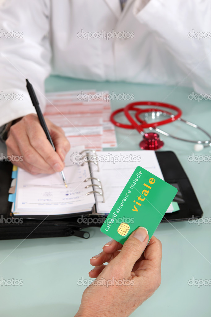Patient handing social security card to doctor — Stock Photo #10516869