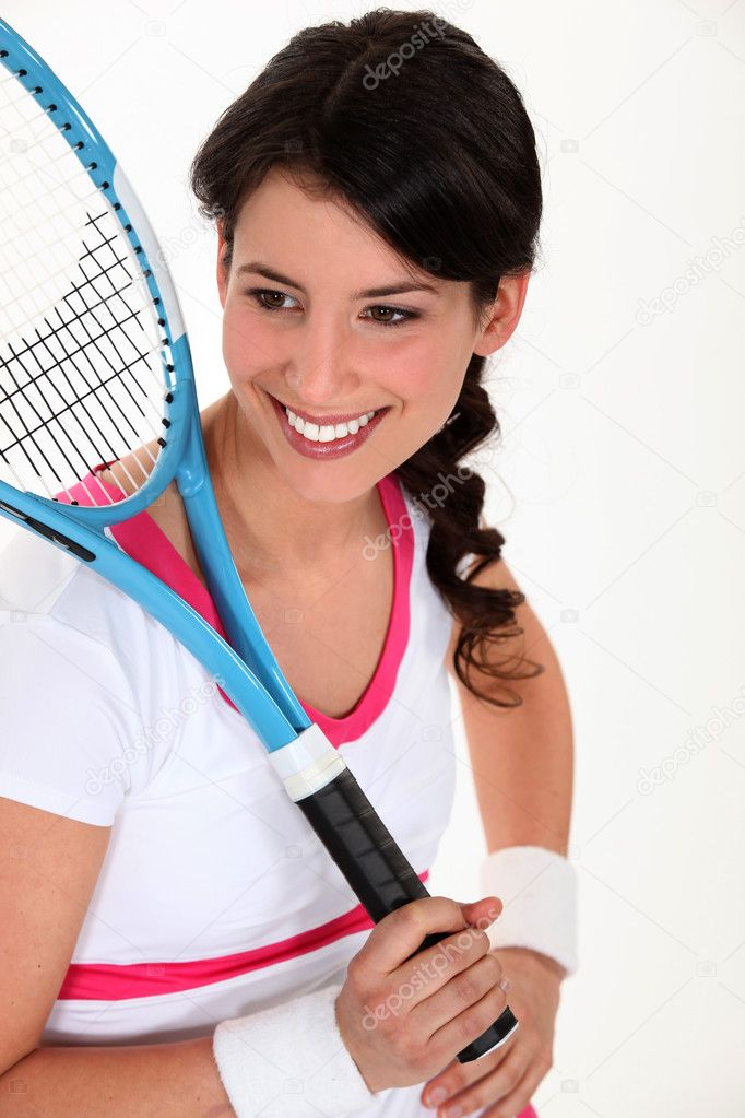 Young woman playing tennis — Stock Photo #10518032