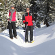 Couple cross-country skiing — Stock Photo
