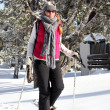 Woman wearing snow shoes - Foto de Stock