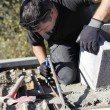 Roofer hard at work - Stock Photo