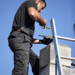 Roofer making a chimney stack - Stock Photo