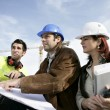 Staff on construction site — Stock Photo