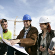 Teamwork on a building site — Stock Photo