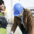 Foreman and colleague working on site — Stock Photo