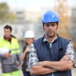 Royalty-Free Stock Photo: Foreman stood in front of two colleagues