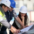 Construction team on site — Stock Photo #10520588