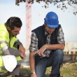 Construction workers discussing plans — Stock Photo