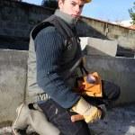Mason working on building foundations — Stock Photo