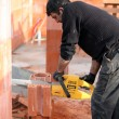 Stock Photo: Mason sawing bricks