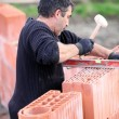 Adjusting wall with wooden mallet — Stock Photo #10520756