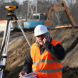 Stock Photo: Surveyor on the phone