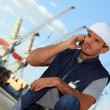 Stock Photo: Foremon phone in construction site