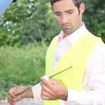 Man checking his oil dipstick — Stock Photo