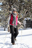 Woman wearing snow shoes — Stock Photo