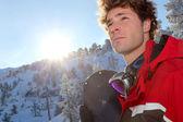 Young man snowboarding — Stock Photo